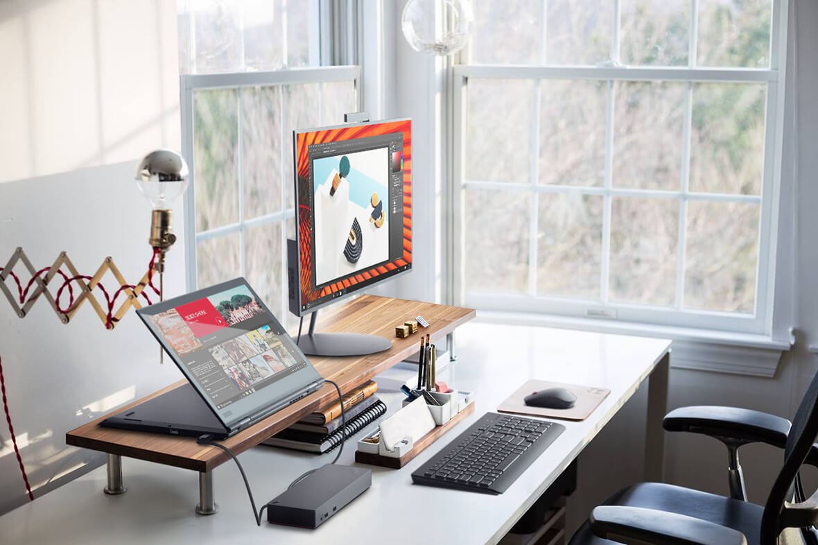 Lenovo ThinkPad X1 Yoga laptop on desktop, with Thunderbolt port connected to monitor.